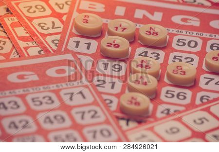Business Concept : Red Bingo Card With Red Chip In Vintage Style. (selective Focus)