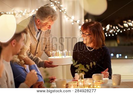 celebration and family concept - happy family having birthday party at home