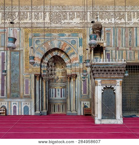 Cairo, Egypt - January 8 2019: Colorful Decorated Marble Wall With Engraved Mihrab (niche) And Woode