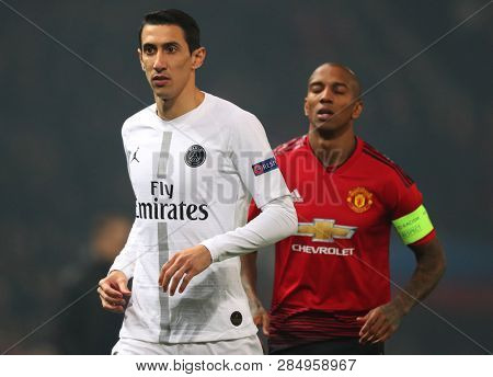 MANCHESTER, ENGLAND - FEBRUARY 12 2019: Angel Di Maria of PSG and  Ashley Young of Manchester United during the Champions League match between Manchester United and Paris Saint-Germain