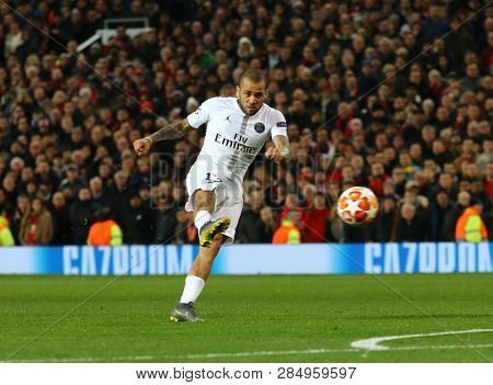 MANCHESTER, ENGLAND - FEBRUARY 12 2019: Dani Alves of PSG takes a shot during the Champions League match between Manchester United and Paris Saint-Germain at Old Trafford Stadium.