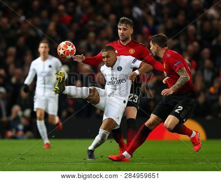 MANCHESTER, ENGLAND - FEBRUARY 12 2019: Luke Shaw of Manchester United  and Kylian Mbappe of PSG during the Champions League match between Manchester United and Paris Saint-Germain at Old Trafford