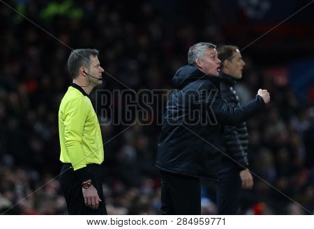MANCHESTER, ENGLAND - FEBRUARY 12 2019: Ole Gunnar Solskjaer Manager of Manchester United and Thomas Tuchel Manager of PSG during the Champions League match between Manchester United and PSG