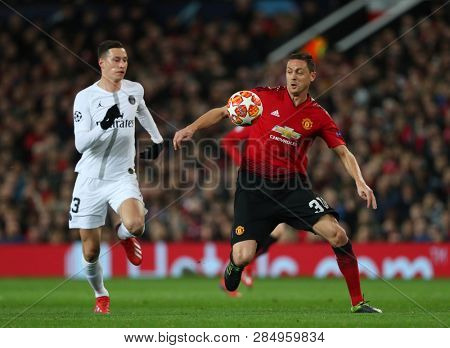 MANCHESTER, ENGLAND - FEBRUARY 12 2019: Julian Draxler of PSG and Nemanja Matic of Manchester United during the Champions League match between Manchester United and Paris Saint-Germain at Old Trafford