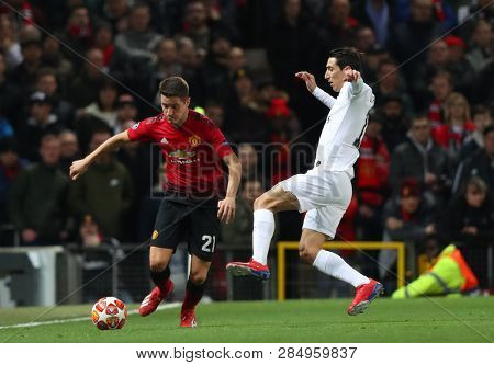 MANCHESTER, ENGLAND - FEBRUARY 12 2019: Ander Herrera of Manchester United and Angel Di Maria of PSG during the Champions League match between Manchester United and Paris Saint-Germain at Old Trafford
