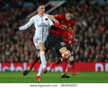 MANCHESTER, ENGLAND - FEBRUARY 12 2019: Julian Draxler of PSG and Nemanja Matic of Manchester United compete for the ball during the Champions League match
