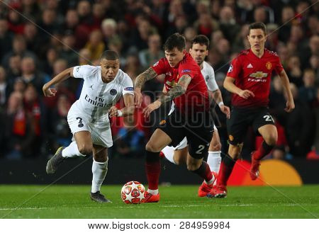 MANCHESTER, ENGLAND - FEBRUARY 12 2019: Kylian Mbappe of PSG and Victor Lindelof of Manchester United during the Champions League match between Manchester United and Paris Saint-Germain