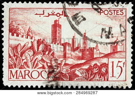 Luga, Russia - January 24, 2019: A Stamp Printed By Morocco Shows View Of Ancient Walled Town, Circa
