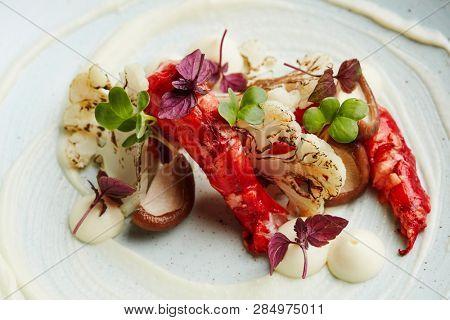 gourmet dish with praws, shitake mushrooms and cauliflower