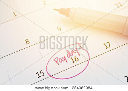 Business, Finance, Savings Money, Wages, Payroll Or Accounting Concept : Calendar With Pink Marker C