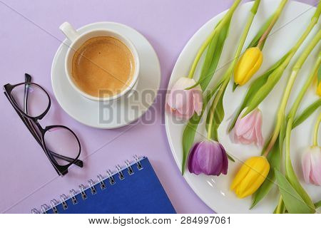 Cup Of Coffee And Tulips On Spring Table