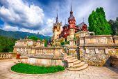 Famous Neo-Renaissance Peles castle and ornamental garden in Sinaia Carpathian Mountains in Europe. Sinaia, Prahova County, Romania poster