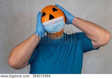 Halloween Pumpkin In A Medical Mask. Person With Orange Evil Mask. Jack Lantern Mask From A Basketba