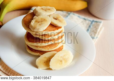 Sweet Homemade Stack Of Pancakes With Banana. Delicious Breakfast.
