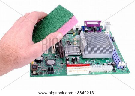 man hand with a sponge cleans a mother board isolated