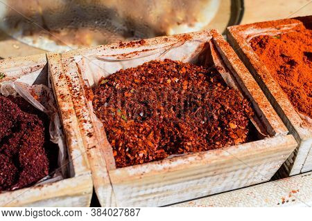 Hot Peppers Spice Powder In A Wooden Bowl Displayed On A Table For Spicing Food
