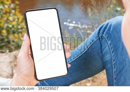 Mockup Cell Phone. Woman With Smart Phone In Park. Closeup Of Hand Holding A Mobile Phone With White