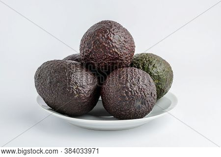 Five Ripe Ready To Eat Avocado Fruits On A White Plate On A White Table