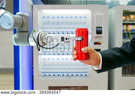 Close-up Industrial Robotic Gripping Red Soda Can For Sending To Businessman Via Smart Automatic Bev