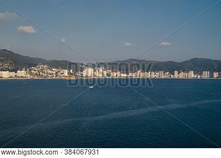 Acapulco, Mexico - November 25, 2008: The Blue Water Bay With Beach And Highrise Buildings Along Sho