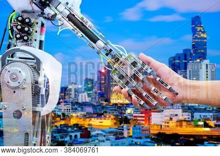 Ai Robot Handshake With Human For ่join On Teamwork On Blurred Building Construction On Blue Tone Co