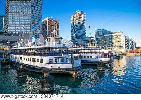 Toronto, Ontario, Canada - Oct 29,  2019: Passenger ferry docked at terminal ready to cross Toronto  harbor. Canada.