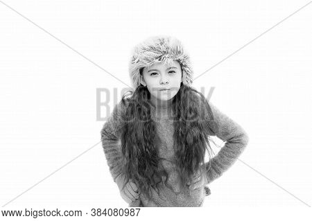 Static And Frizz. Adorable Child Long Hair Soft Fur Hat. Child Care Concept. Girl Long Hair Wear Fur