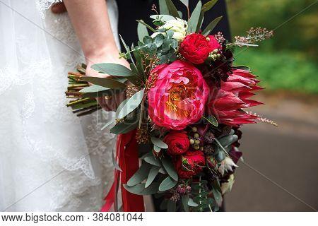 Wedding Bouquet Of The Bride. Floristics, Festive Decoration Of Fresh Flowers Of The Wedding Ceremon