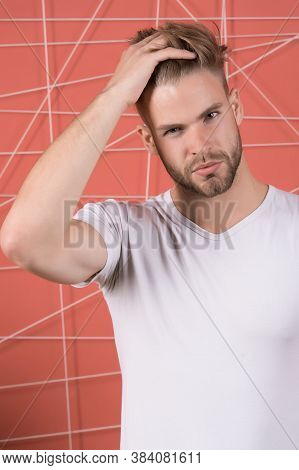 Bearded Man Touch Hair And Stylish Haircut. Macho With Beard On Unshaven Face. Guy With Healthy Youn