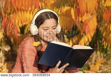 Visual And Audio Information. Schoolgirl Study. Study Every Day. Girl Read Book Autumn Day. Little C