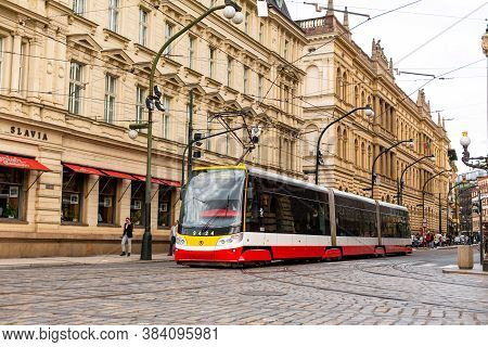 Streets Of The Old Town Prague. A Red Tram Is Going Down The Street. Prague / Czech Republic - 05.21