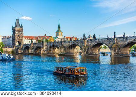 Summer Landscape Of Prague View Of The Ltava River And The Famous Charles Bridge. Prague / Czechia -