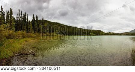 Panoramic Beautiful View Of Emerald Lake During A Cloudy Summer Day. Located Near Whitehorse, Carcro