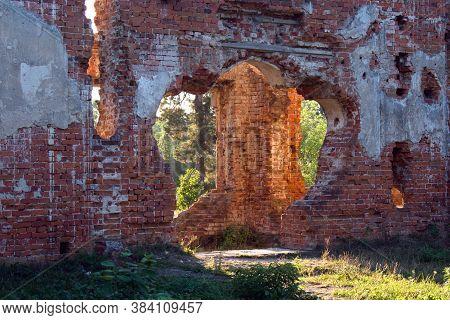 Sunlight Penetrates Through Openings Of Brick Walls Of Ruined Castle