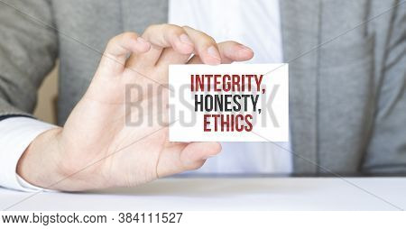 Businessman Holding A Card With Text Integrity, Honesty, Ethics