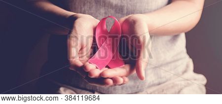 Woman Holding Pink Ribbon, Breast Cancer Awareness, October Pink Concept