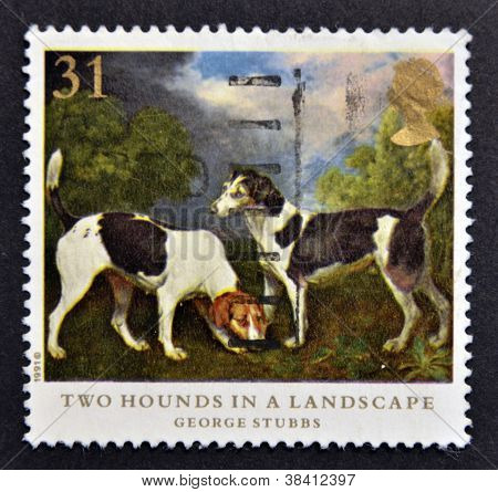 UNITED KINGDOM - CIRCA 1991: A stamp printed in Great Britain shows Two hounds in a landscape painti