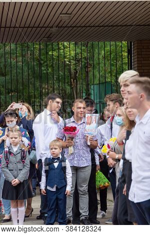 Russia - September 1, 2020. High School Students Stand Near The School On A Solemn Line Dedicated To