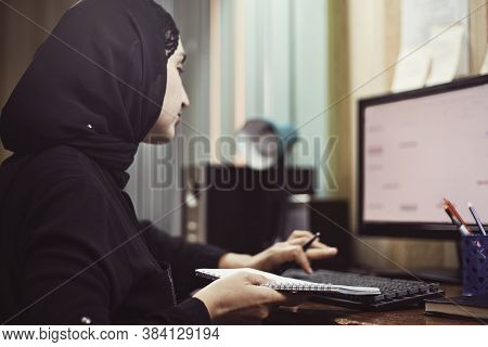 Middle Eastern Female Entrepreneur. Busy Arabian Businesswoman. A Middle-aged Woman In Traditional A