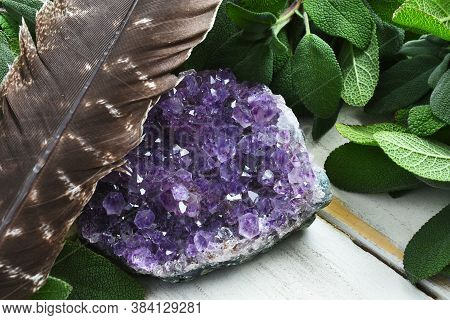 A Close Up Image Of White Sage And Sparkling Amethyst Geode.