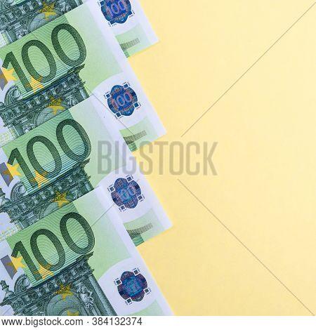 Euro Cash On A Yellow Background. Euro Money Banknotes. Euro Money.