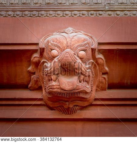 Indonesian Style Hindu Stone Sculpture Carved On The External Wall Of Historical Palace Of Baron Emp