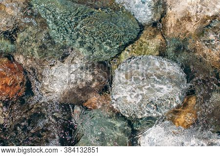 Different River Rocks Under Clean Water With Moth. Stones Under Water. Background.sea Stones In The