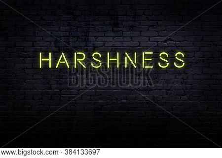 Neon Sign On Brick Wall At Night. Inscription Harshness