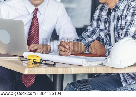 Contractor Construction Engineer Meeting Together On Architect Table At Construction Site. Business