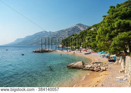 Makarska, Croatia - September 5, 2019: Beautiful beach at Adriatic Sea in Makarska Riviera, Dalmatia, Croatia