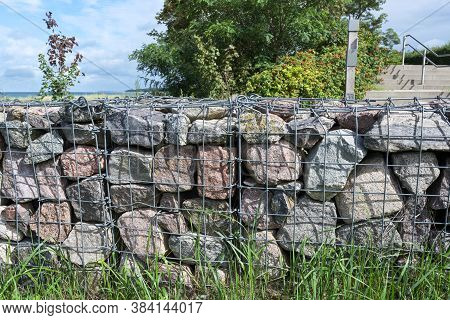Gabions, Stones In Wire Cages Are A Modern Design Option In Gardens And Landscapes As Fortifications