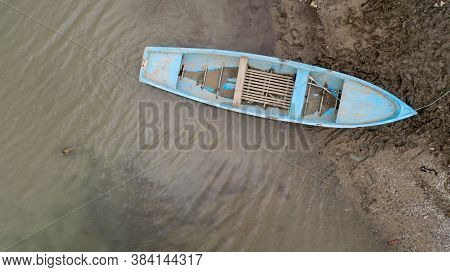 Lonely Fishing Boat On Lake. Aerial Photo, Top View