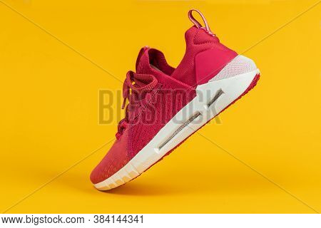 Running Sports Shoe On Yellow Background. Running Shoe, Sneaker Or Trainer. Women's Athletic Shoe. F