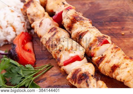 Close Up Chicken Skewers On Wooden Board